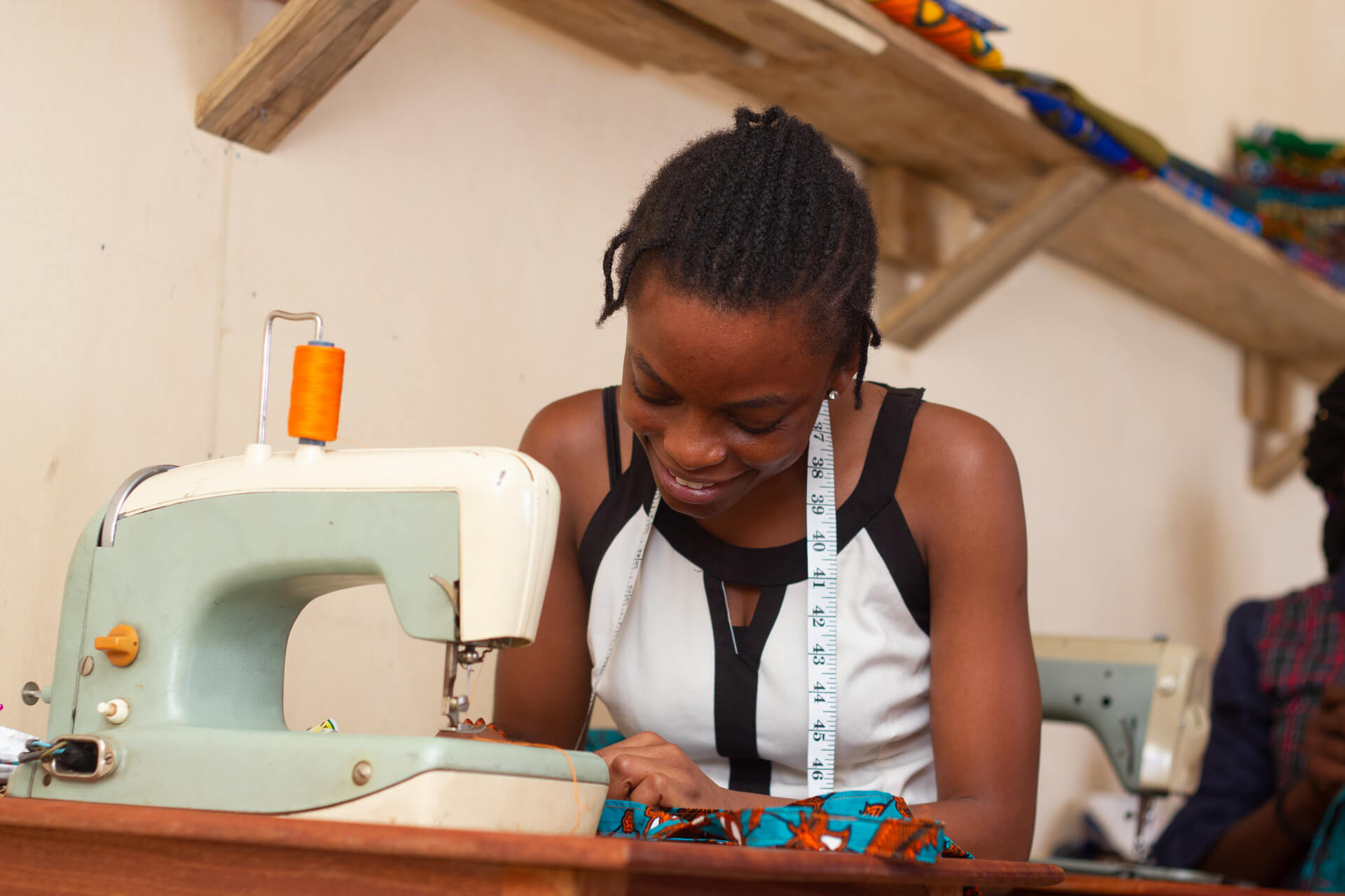 photo of Ghanaian woman getting sewing lessons